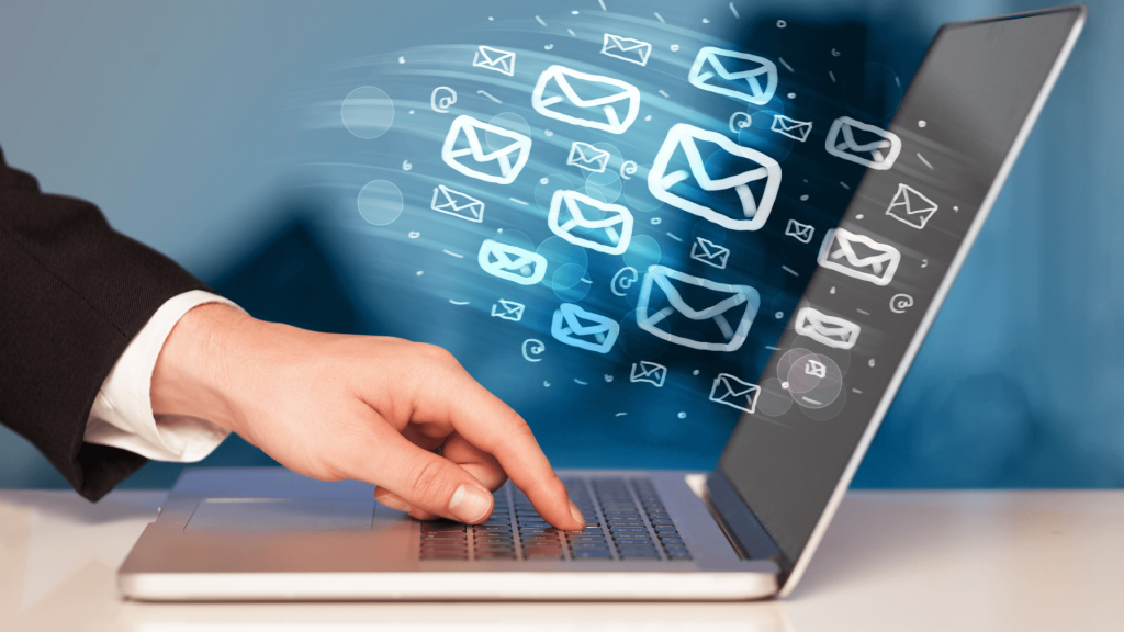 email envelopes fly into a computer