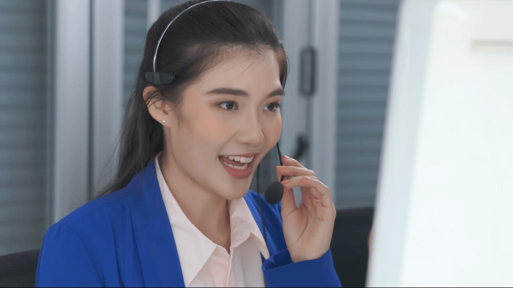 a businesswoman speaks on a headset